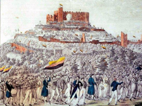 Zug zum Hambacher Fest. – Teilkolorierte Federzeichnung von 1832. Die Flaggen zeigen die damals so gewählten deutschen Landesfarben Gold-Rot-Schwarz.